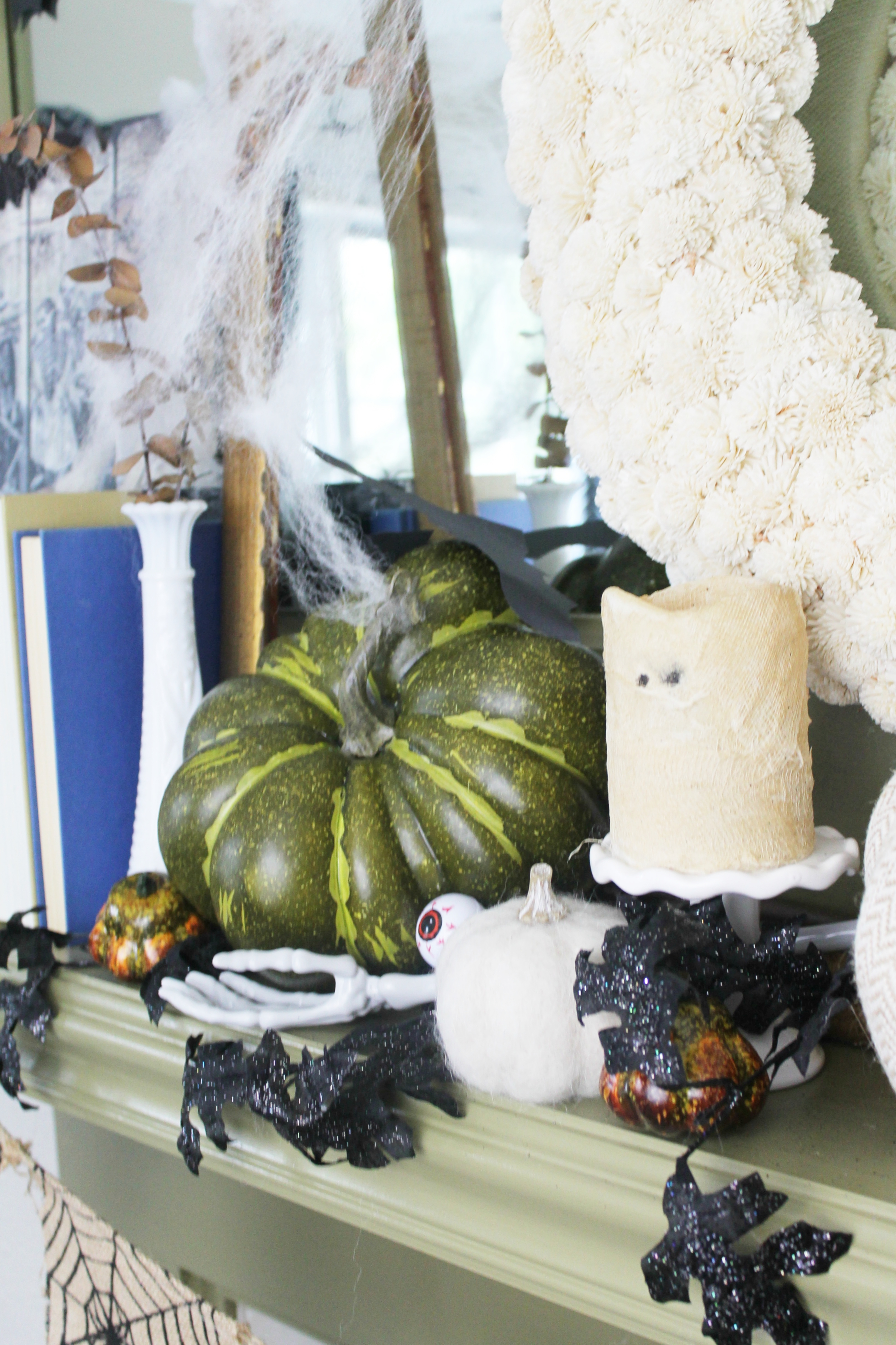a spooky tablescape mantle maddie butterfield blog